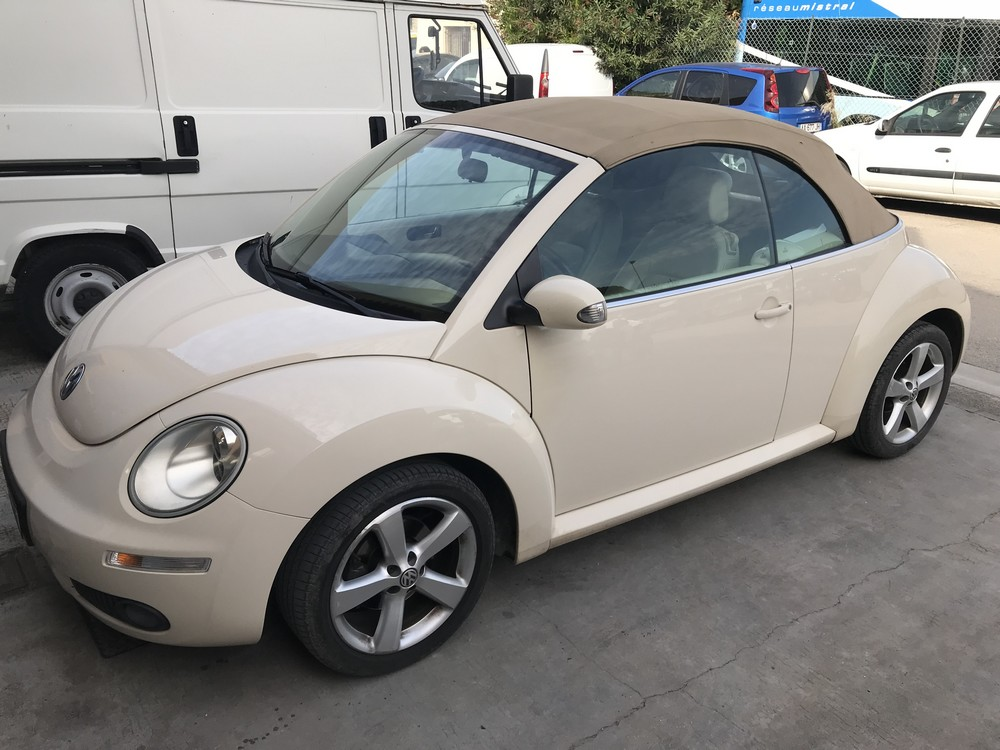 changer capote new beetle